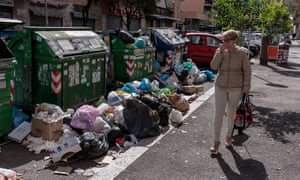 Rubbish overflowing on the street in Cinecittà neighbourhood in Rome, Italy.