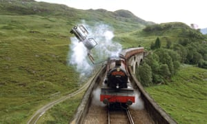 Harry Potter, with Ron Weasley driving,  in pursuit of the Hogwarts Express, in Harry Potter and the Chamber of Secrets.