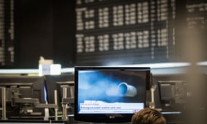 Stock Exchange in Frankfurt am Main<br>04 Nov 2015, Rhineland, Germany --- A monitor shows the exhaust pipe of a diesel car, which emits blue smoke, in the trade room of the stock exchange in Frankfurt am Main, Germany, 04 November 2015. Further bad news from Volkswagen prevented the leap over the 11,000-point mark at the German Stock Exchange. The VW preferred share temporarily fell more than 9 percent. Photo: FRANK RUMPENHORST/dpa --- Image by © Frank Rumpenhorst/dpa/Corbis