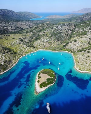 Drone image of Kyra Panagia. Kyra Panagia is in the Northern Sporades, and only has a population of 10. Since 963AD, the island has belonged to the Holy Monastery of Megisti Lavra on Mount Athos, which also maintains it. There is a monastery on the east coast of the island that has been restored, which islanders come to worship at on trawlers and private boats.