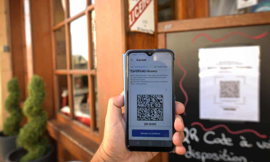 A person checks into a restaurant in France using a QR code with an EU Covid digital vaccine certificate.
