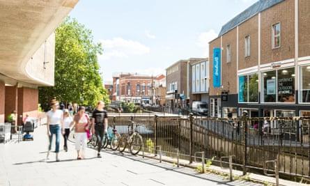 People walking beside a canal