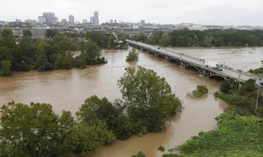 The swollen Congaree river flows under the Gervais Street bridge in West Columbia.