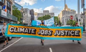 Activist groups and concerned citizens march to New York City Hall in protest of Trump's attack on the Paris climate agreement in June 2017.