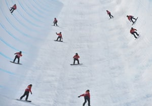Multiple exposure photo showing Patrick Burgener of Switzerland during the men's halfpipe snowboard qualification. Burgener qualified with 82 points.