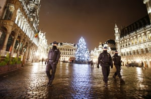 Belgian police officers patrol the Grand Place in downtown Brussels last night