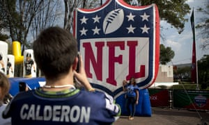 Fans take photos by the NFL logo set up at the third annual American Football Expo in Mexico City.