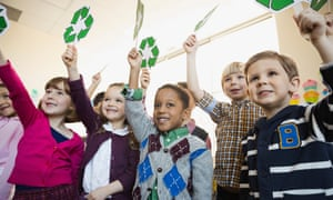children holding recycling signs