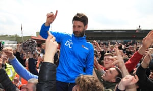 Lincoln City supporters lift up Danny Cowley after the win against Macclesfield that sealed promotion back to the Football League on 22 April 2017