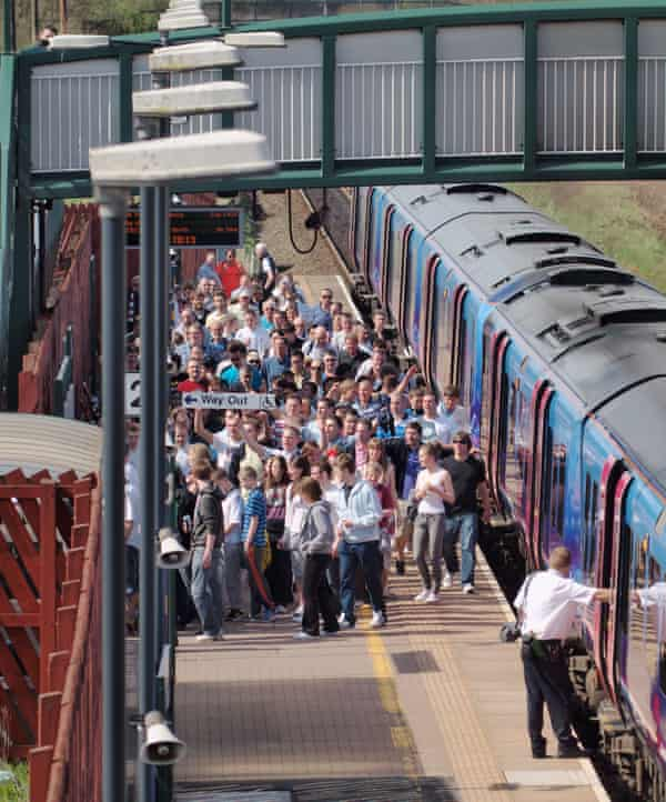 Fans at Horwich Parkway railway station head to a Bolton game.