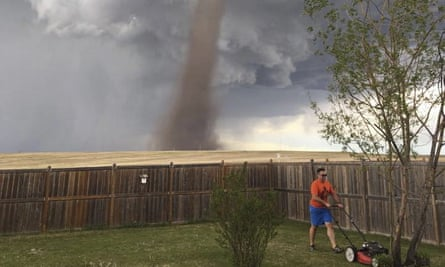 Theunis Wessels mows his lawn at his home in Three Hills, Alberta.