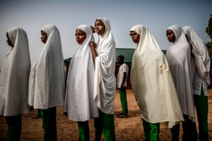 Fulani students queue before the beginning of the day's lessons at Wuro Fulbe Nomadic School in Kachia grazing reserve for Fulani people