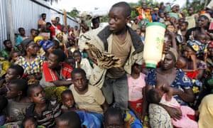 Burundian refugees rest with their belongings on the shores of Lake Tanganyika.