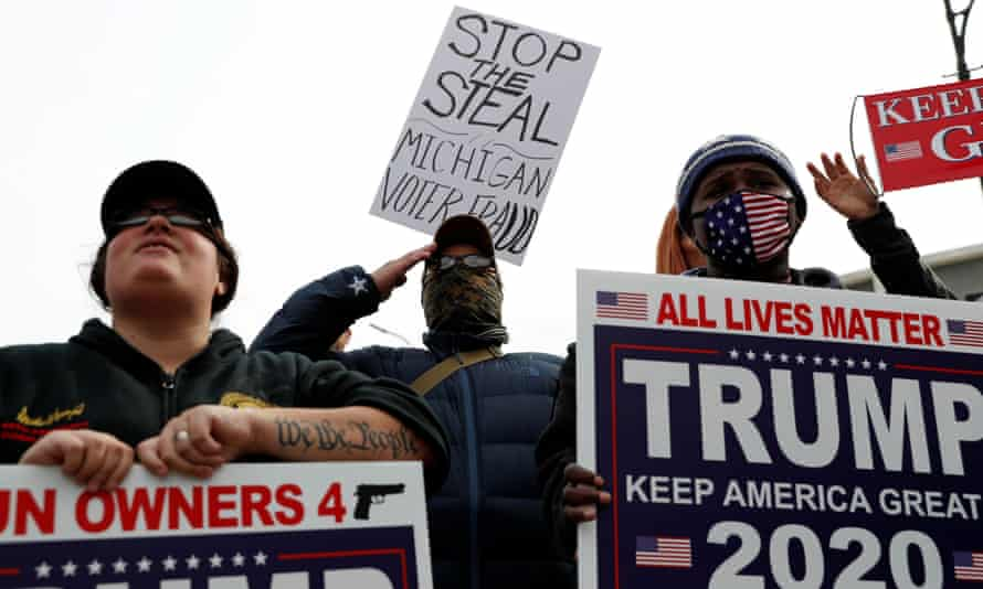 Supporters of Donald Trump rally in Detroit, Michigan on Thursday.