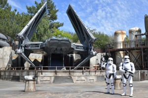 Stormtroopers pose alongside a TIE fighter