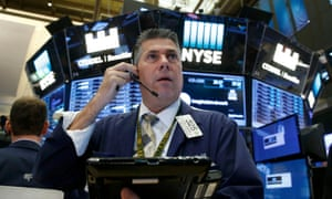 A trader works on the floor of the New York stock exchange today.
