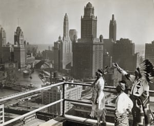 Native Americans look out over Chicago's skyline.