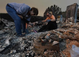 The Reinhardt family sort through the remains of their home destroyed by the Thomas fire