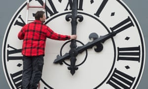 A technician changes a clock on a church in Dresden
