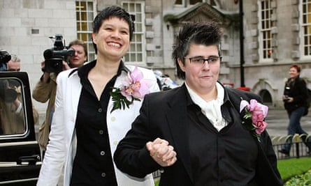 Shannon Sickles (left) and Gráinne Close arrive at Belfast city hall for their civil partnership ceremony.