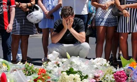 Man cries near flowers