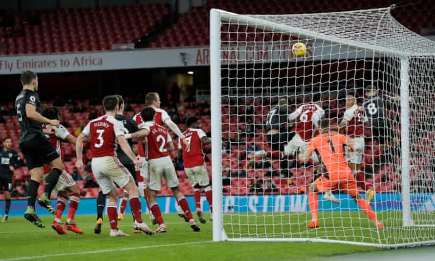 Pierre-Emerick Aubameyang's header skims into the Arsenal net as he scores the own goal that led to Burnley's victory.
