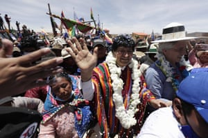 Morales is received, along with the former vice-president Álvaro García Linera (right) by residents of Orinoca