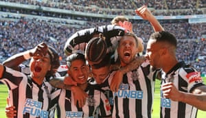 Newcastle players celebrate after Perez made it 3-0.