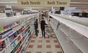 Shelves that normally contain toilet paper at Market Basket grocery store in New Bedford, Massachusetts, are stripped bare.