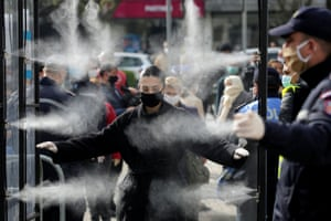 Tirana, Albania  Shoppers are disinfected before entering a market, as authorities take measures to stop the spread of coronavirus