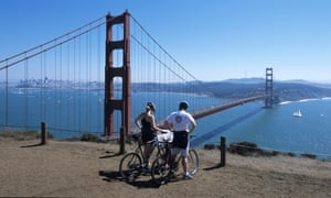 Cyclists overlooking Golden Gate Bridge, San Francisco