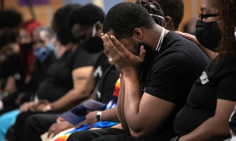 Family members mourn the death of Conrad Coleman Jr from Covid-19 following his funeral service on 3 July in New Rochelle, New York. The African American community has been especially hard-hit by the coronavirus pandemic.