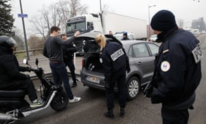 French police officers check vehicles at the French-German border.