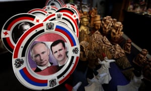 Porcelain plates with portraits of the Syrian president, Bashar al-Assad, right, and his Russian counterpart Vladimir Putin displayed at a handicrafts shop in Damascus.