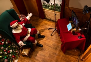 Children Visit Santa Clause At Mall Of America During Coronavirus PandemicBLOOMINGTON, MN - NOVEMBER 24: Santa Larry speaks with a virtual visitor at the Santa Experience in the Mall of America on November 24, 2020 in Bloomington, Minnesota. The owners had initially set up a socially distanced set, featuring a cabin with a plexiglass window, but moved completely online after new COVID-19 restrictions were put in place after last week's executive order from Minnesota Gov. Tim Walz. (Photo by Stephen Maturen/Getty Images)