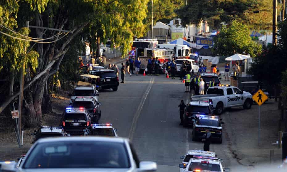 The road into Christmas Hill Park where the Gilroy Garlic Festival is held as emergency vehicles responded to the shooting.