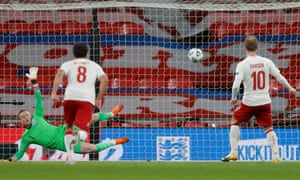 Denmark's Christian Eriksen scores their first goal from the penalty spot.