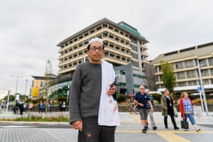 Hamzah Noor Yahaya, a survivor of the shootings at Al Noor mosque, stands in front of Christchurch Hospital and waits to be picked up by his wife.
