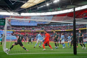 Laporte's header sneaks in at the far post.