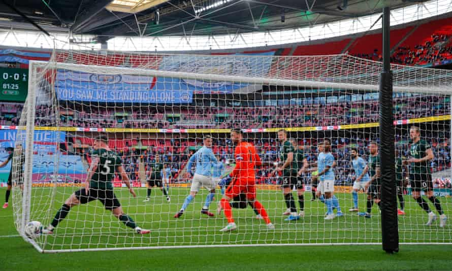 City's Aymeric Laporte scores in the Carabao Cup final.