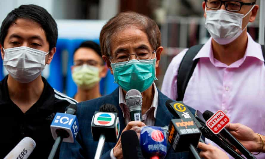 One of those arrested, former lawmaker and pro-democracy activist Martin Lee (centre) talks to the media after leaving the central district police station in Hong Kong.