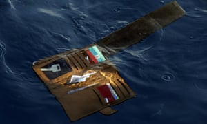 A wallet belonging to a victim of the Lion Air passenger jet that crashed floats in the waters of Ujung Karawang