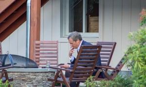 Nigel Farage enjoys a cigarette during a break in proceedings.