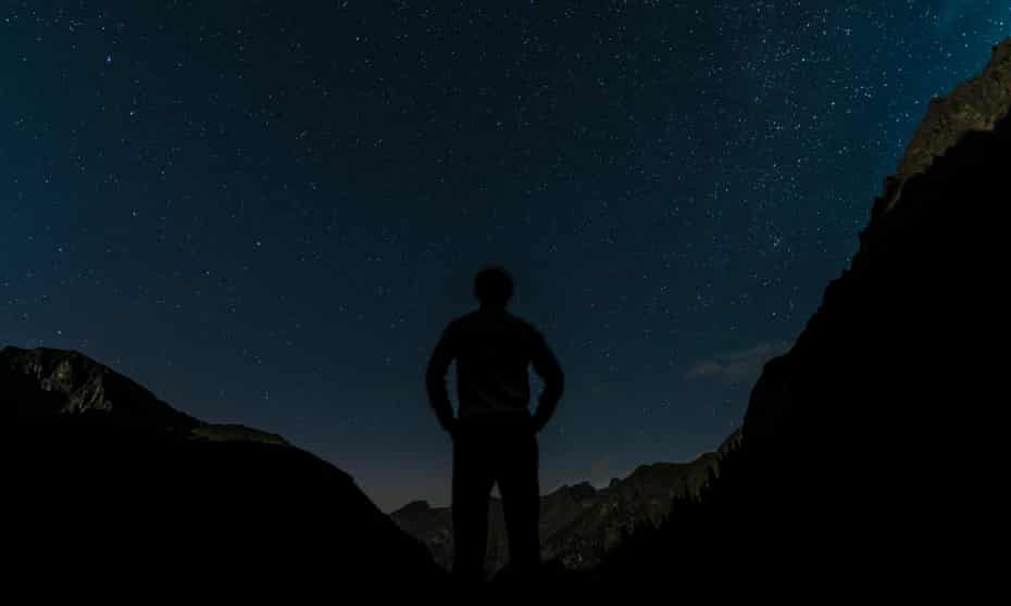 Silhouette of person gazing at the stars