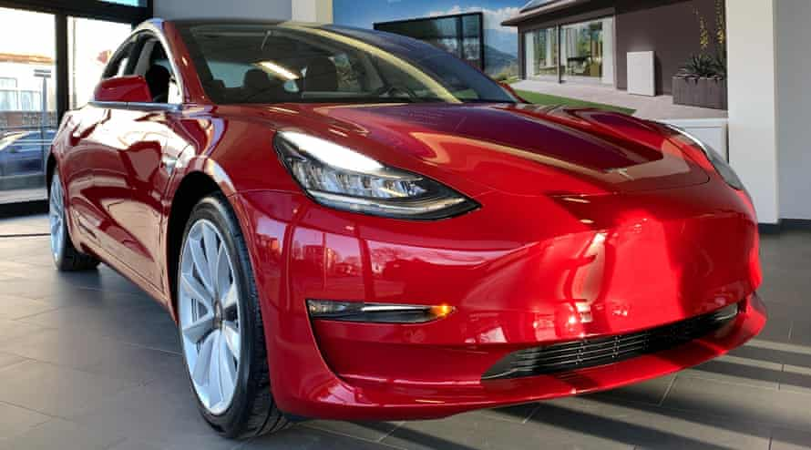 A Tesla Model 3 car on display at a Manchester showroom