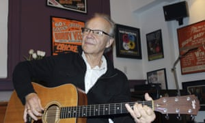 Bobby Vee plays the guitar at his family's Rockhouse Productions in St Joseph, Minnesota in 2013.