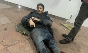 Sebastien Bellin lies wounded on the floor of Brussels airport.