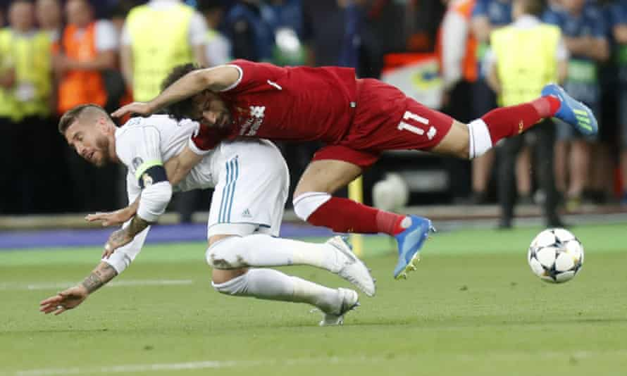 Sergio Ramos tussles with Liverpool's Mohamed Salah in the 2018 Champions League final