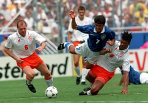 Brazil's Bebeto is tackled by Frank Rijkaard during the first half.