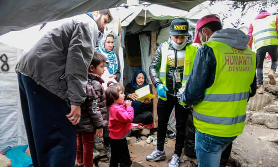 Face masks are distributed to migrants and refugees on the island of Lesbos.